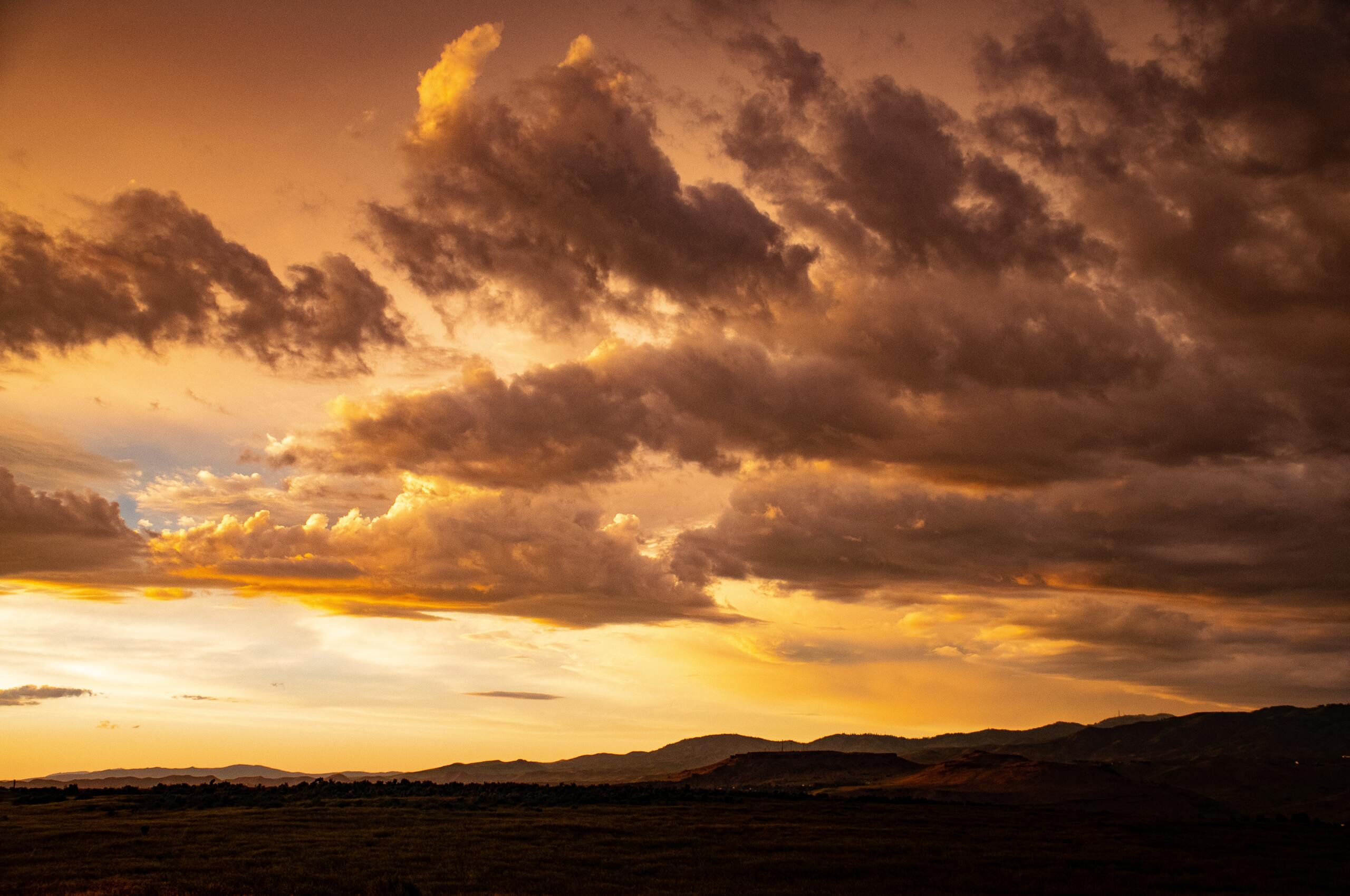orange-sunset-clouds-in-sky-5k-ju.jpg