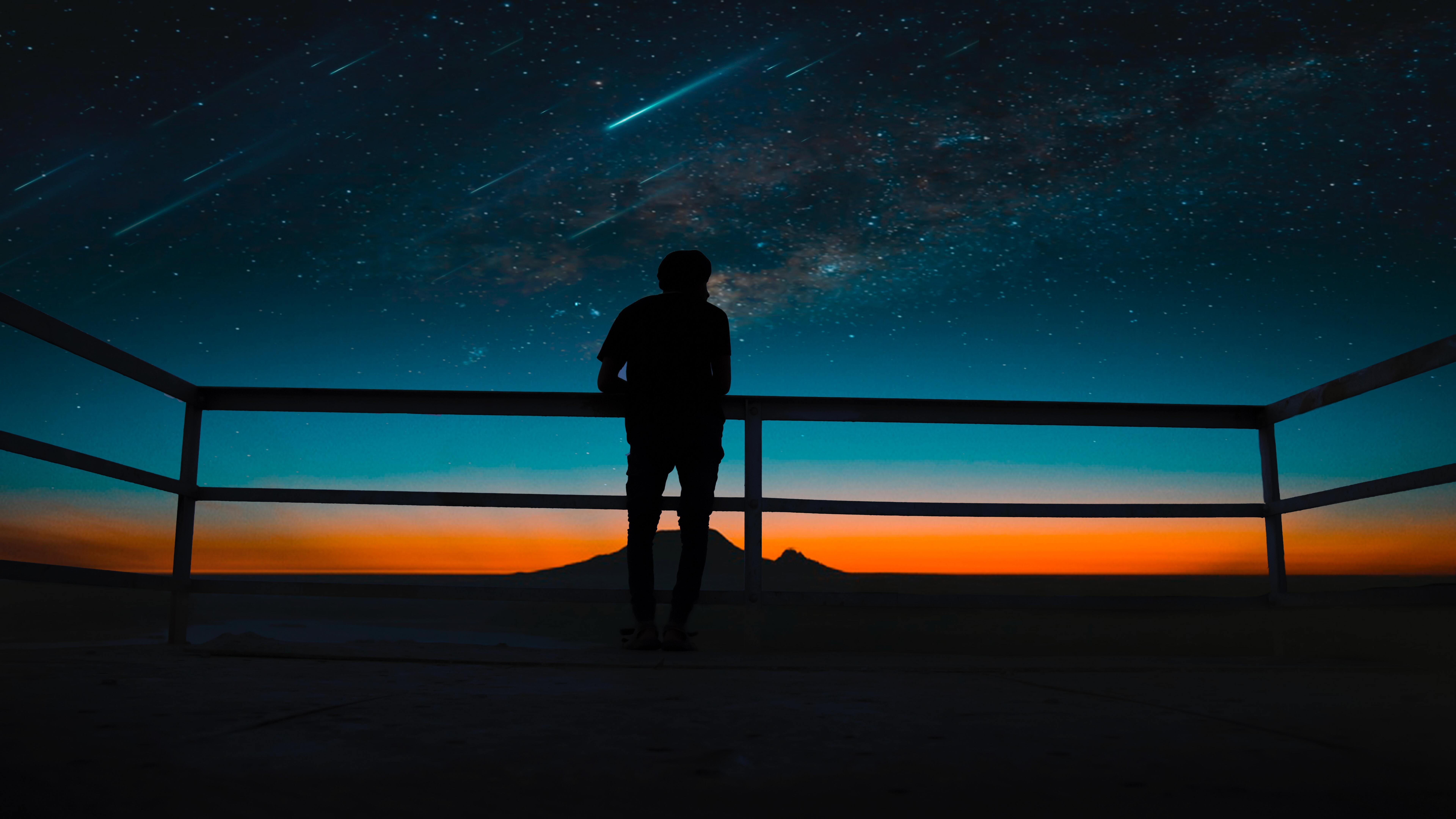 person-silhouette-meteors-night-sky-8k-jz.jpg