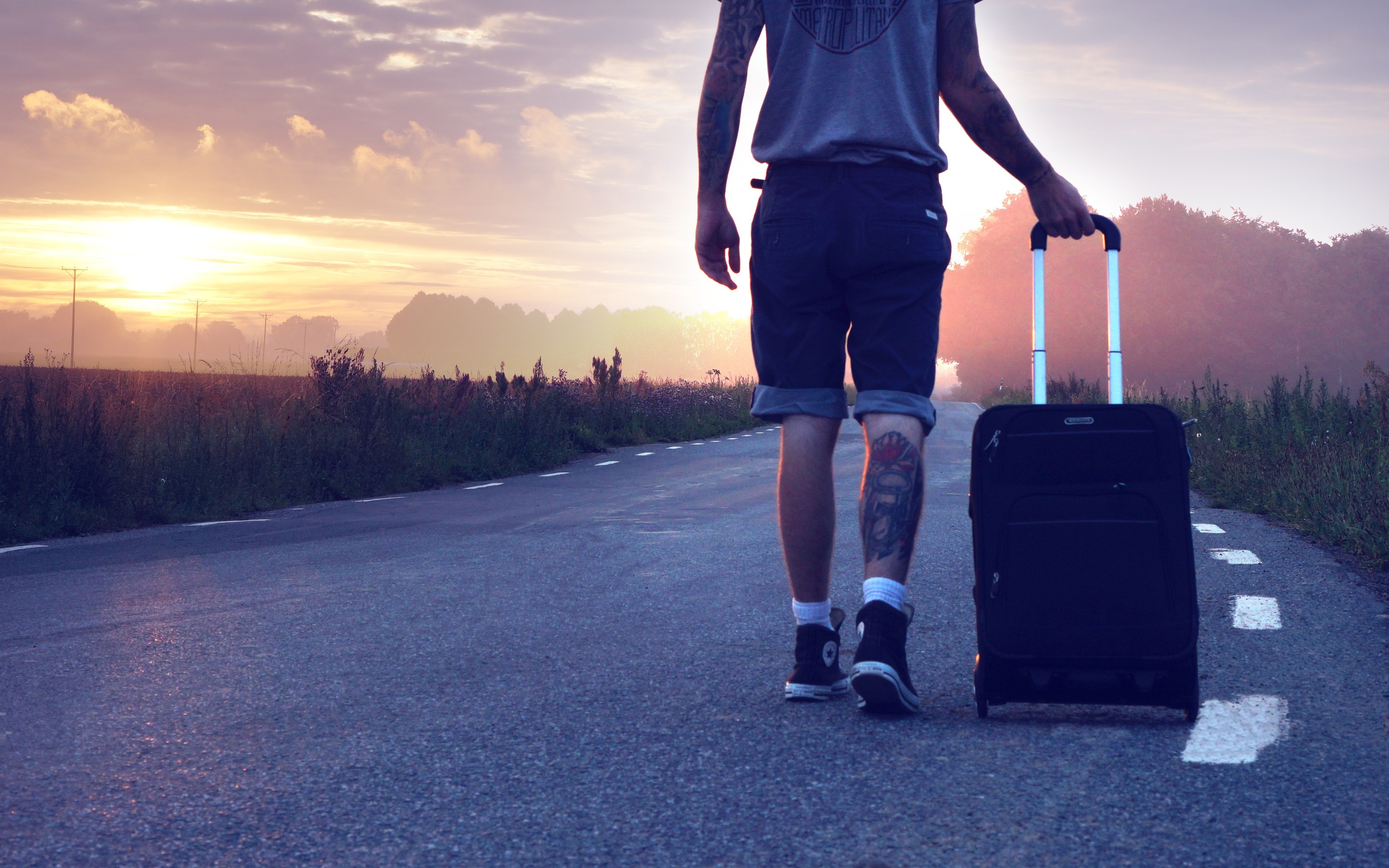 person-walking-on-road-with-suitcase-kv.jpg