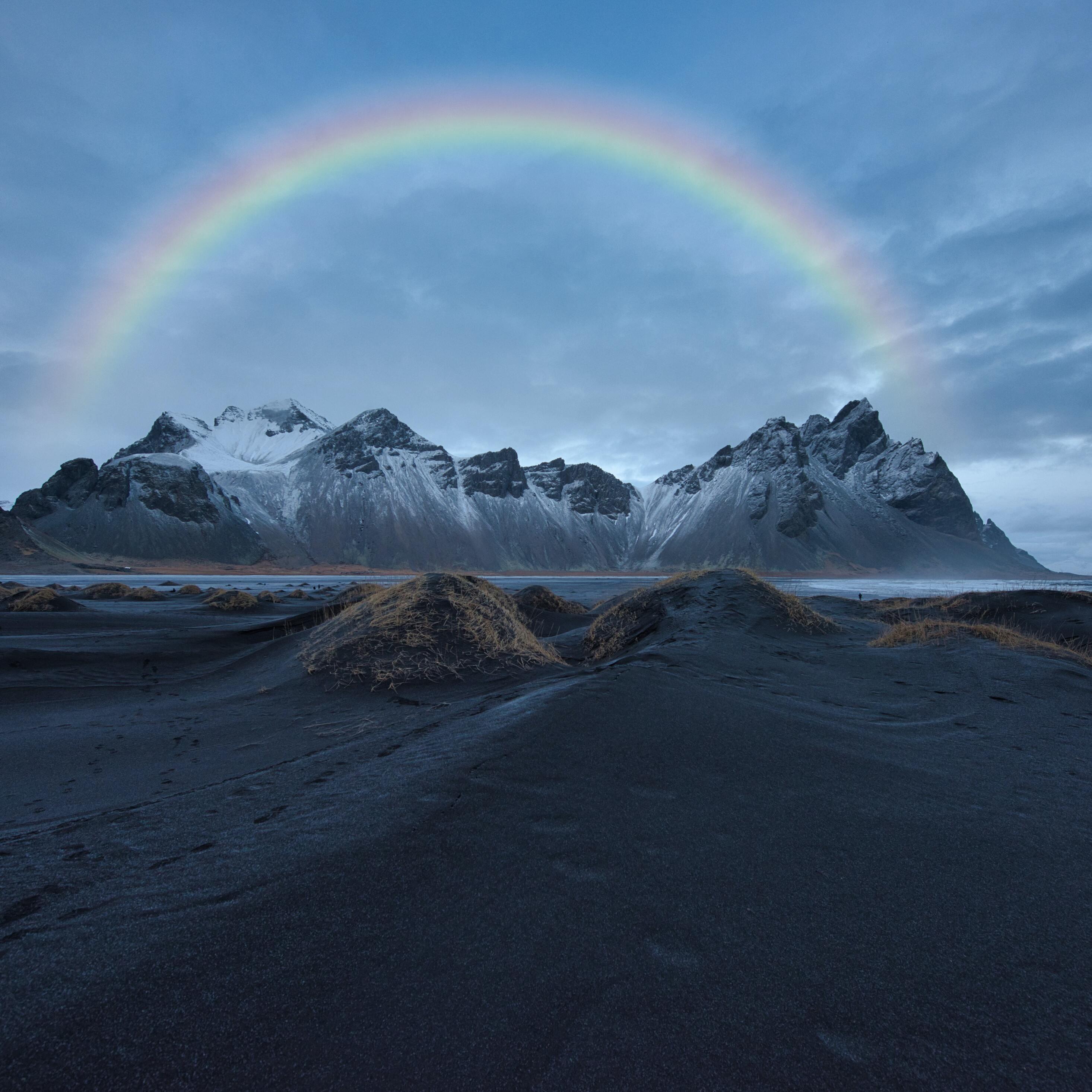 rainbow-over-snow-covered-mountain-8k-lf.jpg