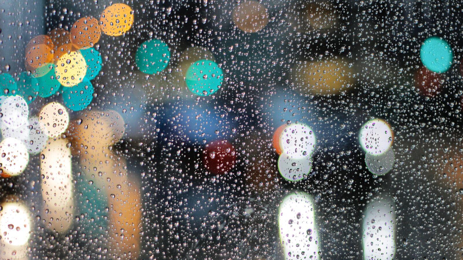https://images.hdqwalls.com/download/rainy-day-drops-on-glass-lights-bokeh-5k-1m-1600x900.jpg