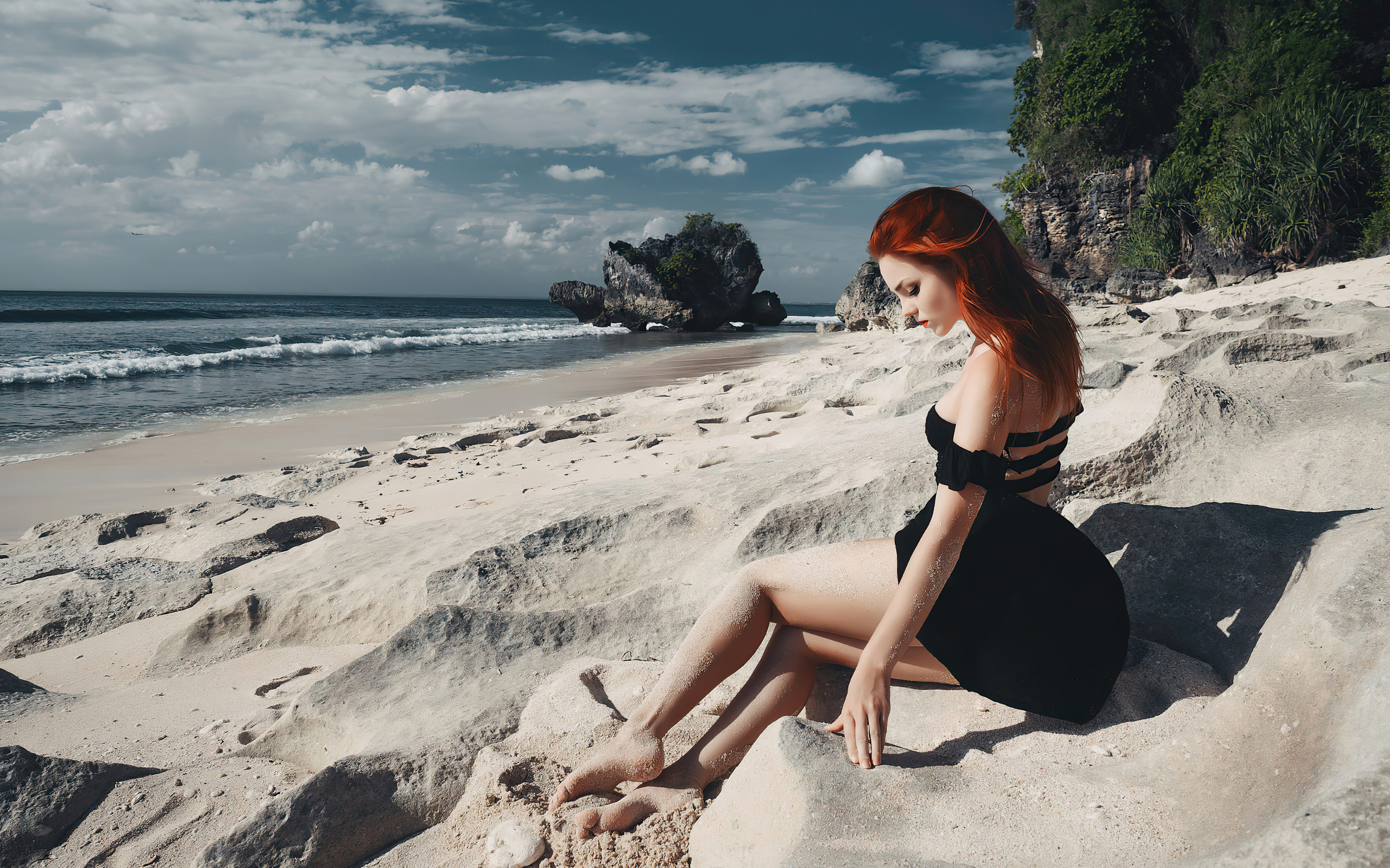redhead-girl-sitting-on-beach-black-clothing-4k-tc.jpg