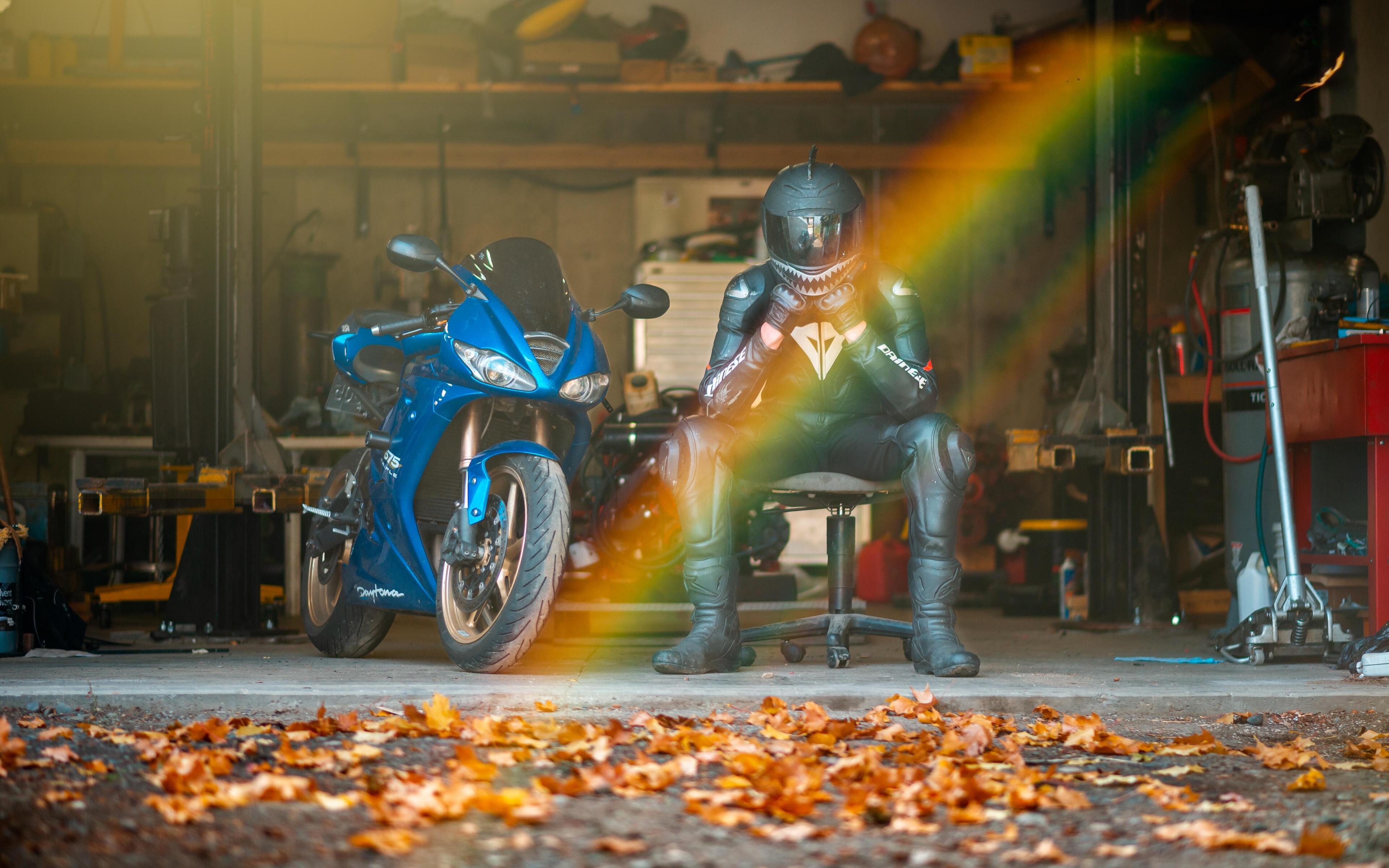 rider-with-daytona-675-triple-sitting-on-chair-or.jpg