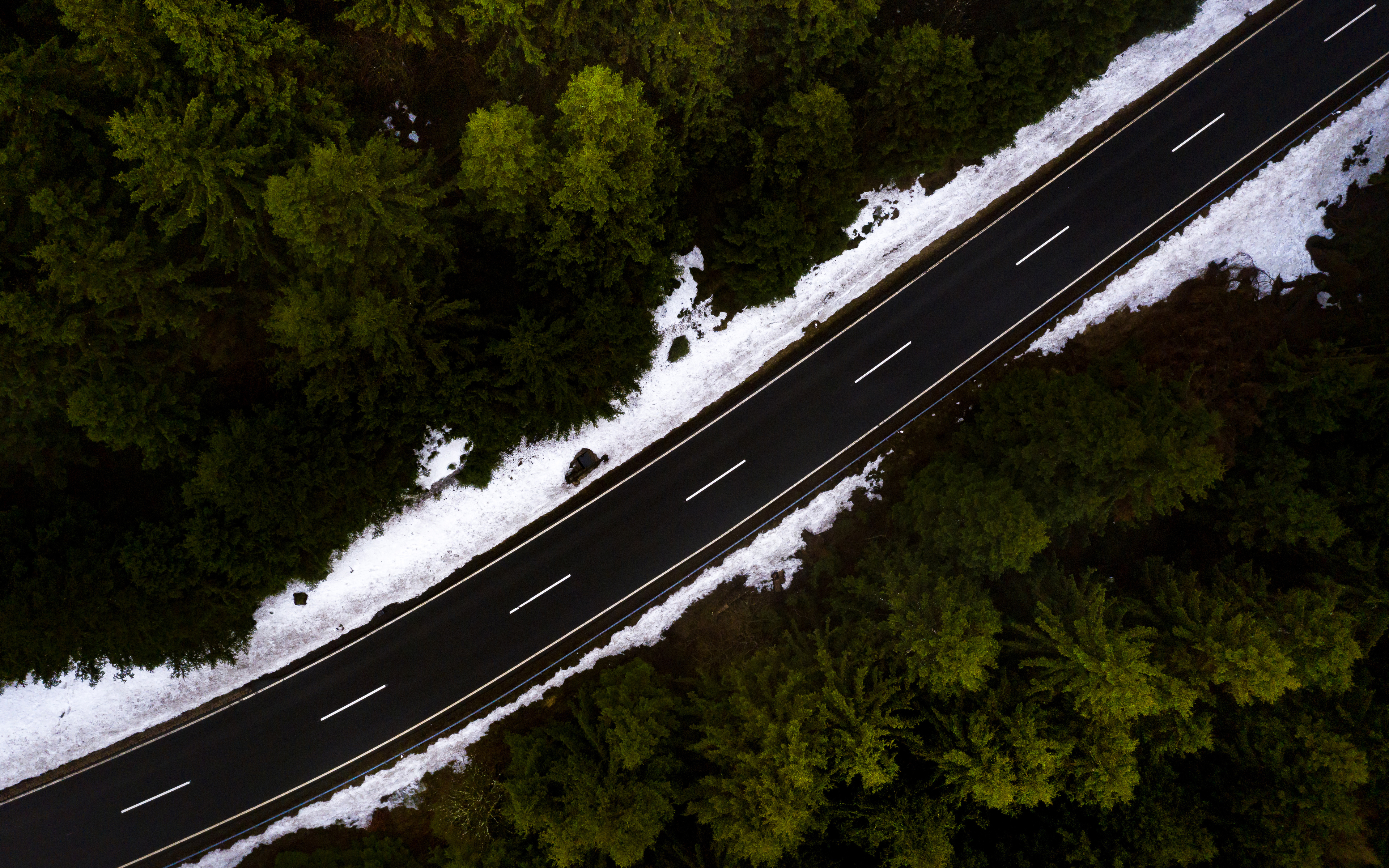 road-through-woods-snow-on-roads-side-5k-74.jpg