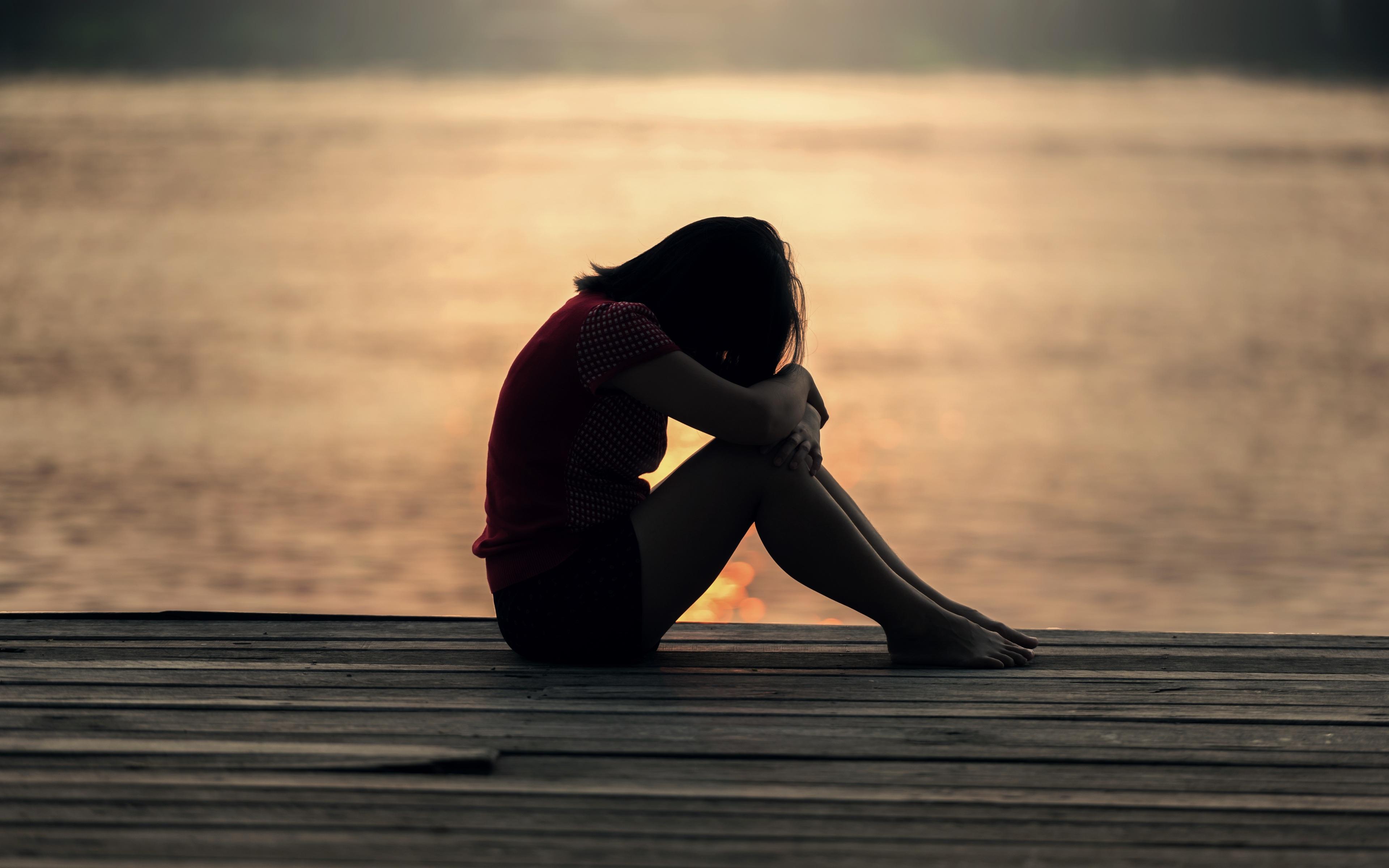 sad-girl-sitting-on-dock-silhouette-nb.jpg