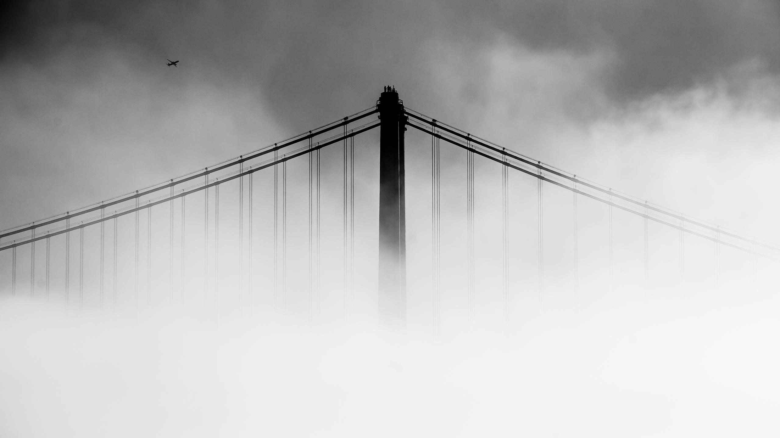 san-francisco-oakland-bay-bridge-covered-with-fog-qg.jpg