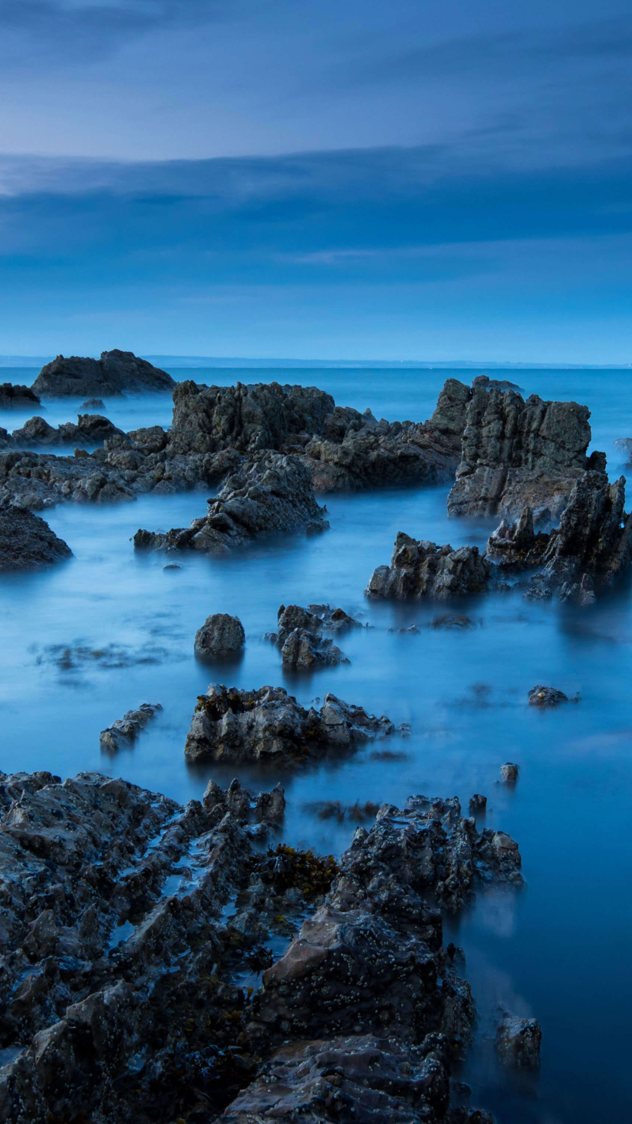 sea-rocks-evening-view-5k-nx.jpg