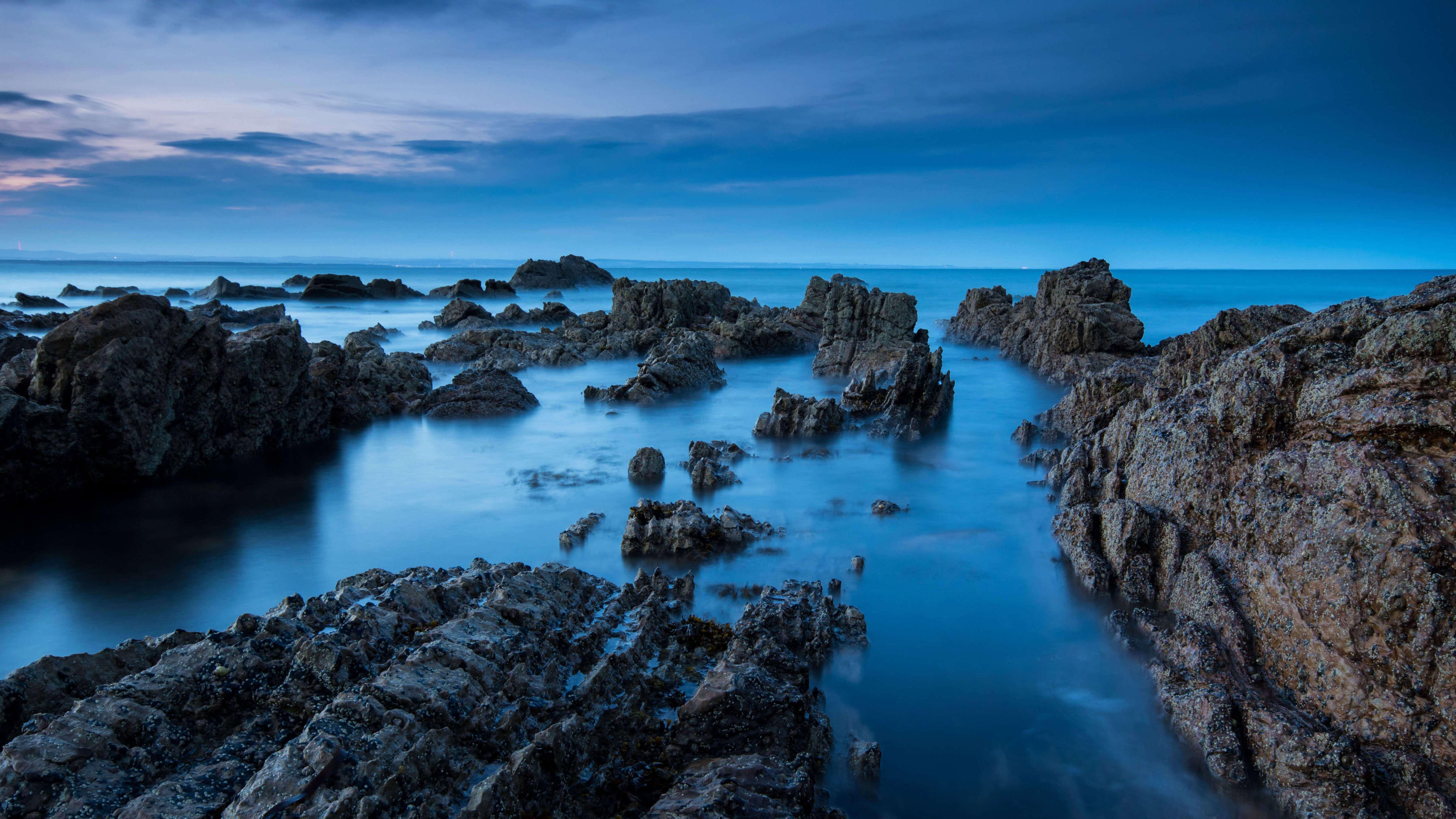 sea-rocks-evening-view-5k-nx.jpg