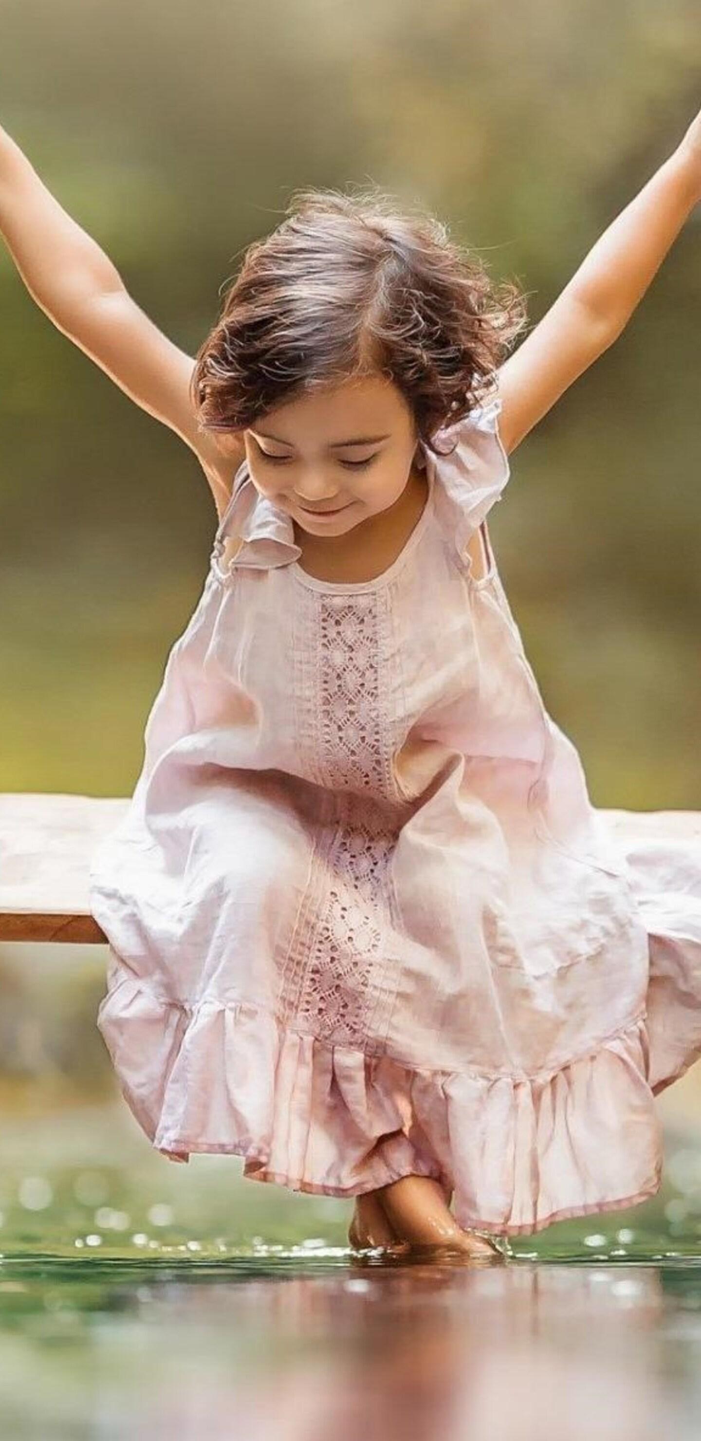 small-girl-taking-swing.jpg