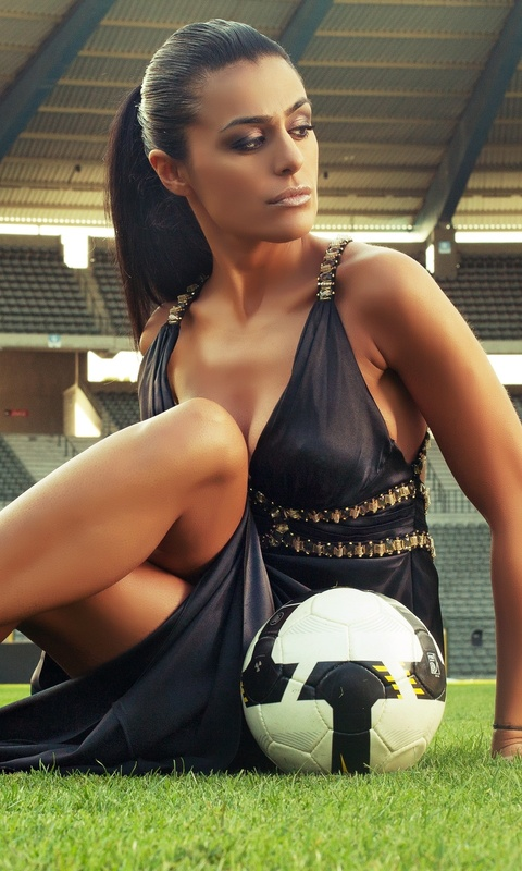 soccer-girl-with-football-in-stadium-q2.jpg