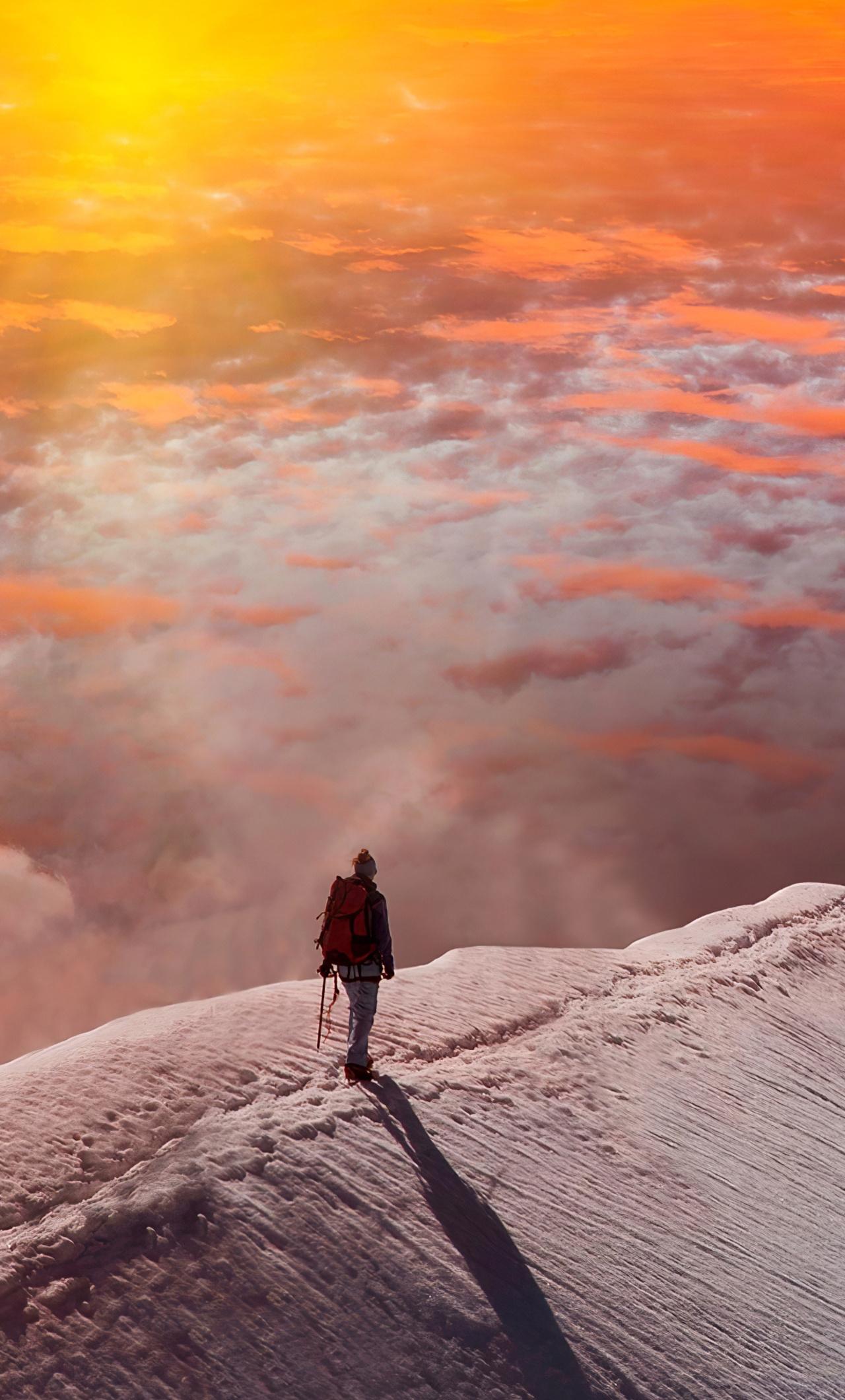 standing-at-snowy-peak-mountain-sunset-fz.jpg