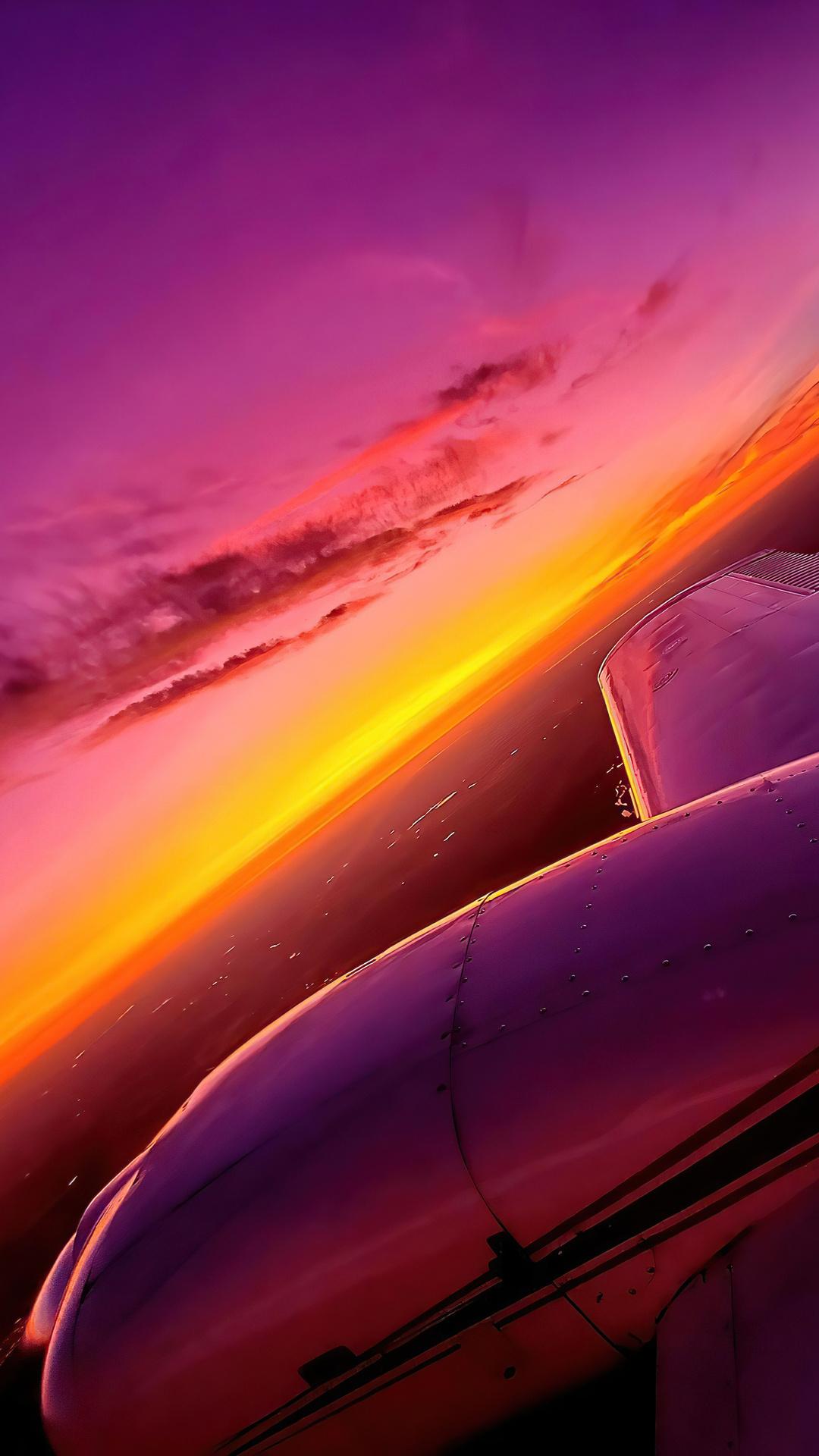 synthwave-sunset-plane-view-4k-ce.jpg