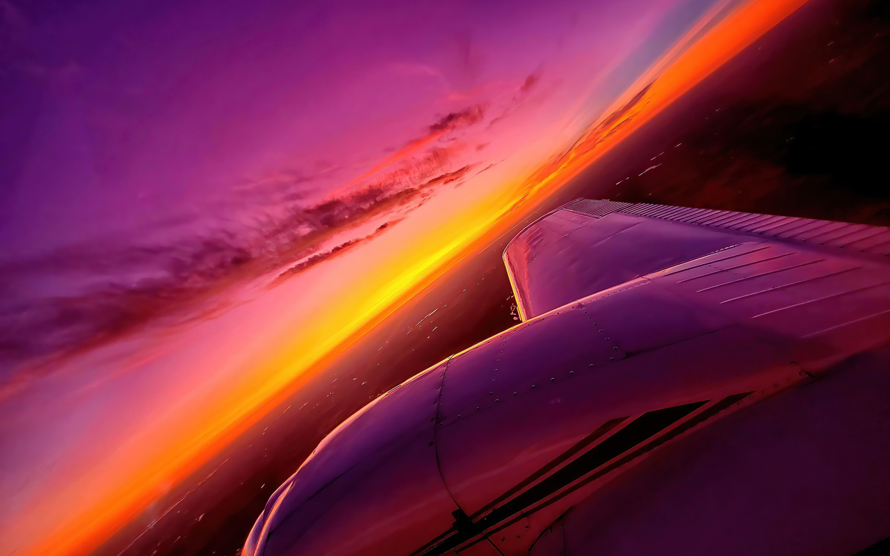 synthwave-sunset-plane-view-4k-ce.jpg