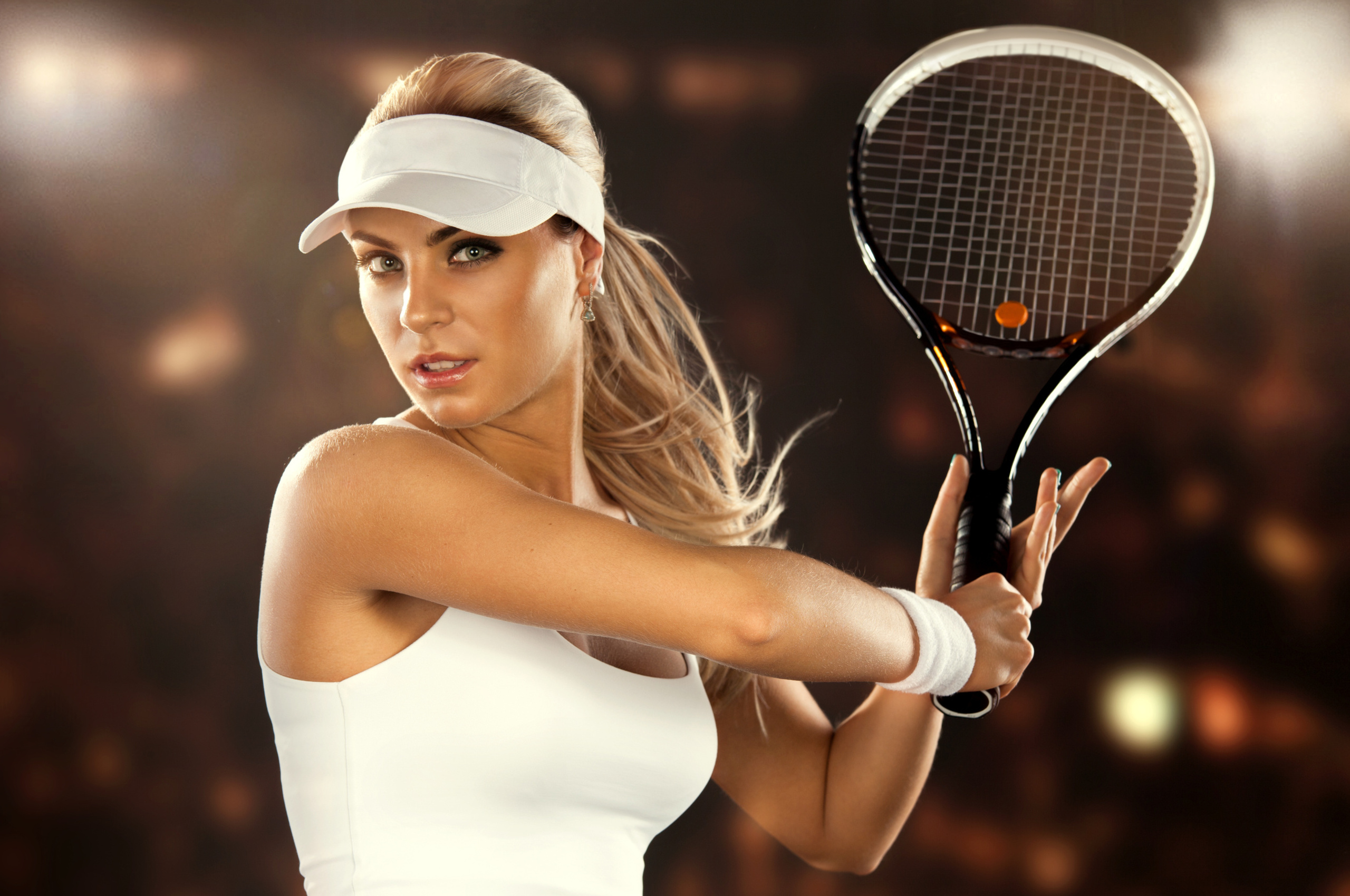 titillating tennis player can't believe the size of his racket  85438
