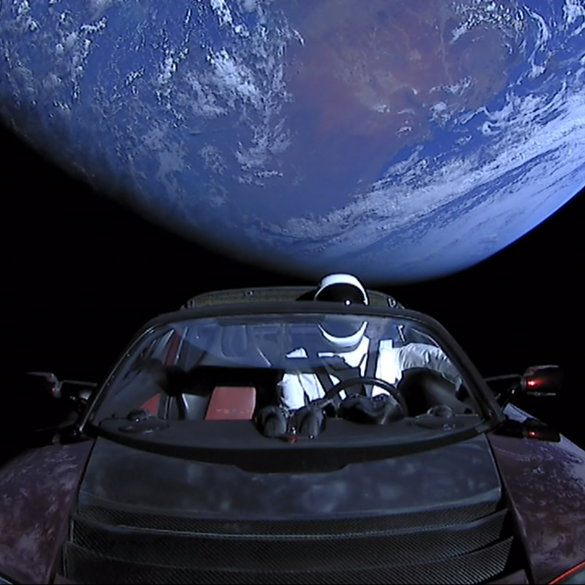 2048x2048 Tesla Roadster Into Space With Space Suit Man
