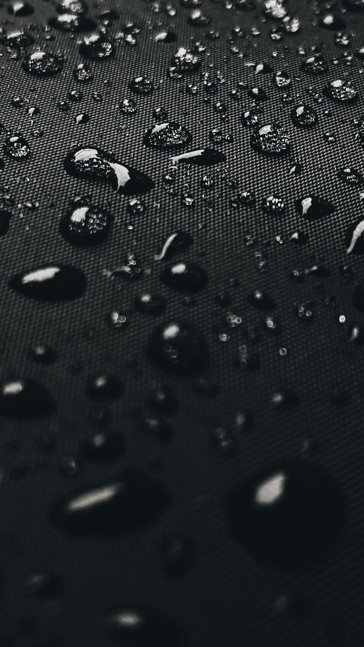 water-drops-on-black-surface-4k-ex.jpg
