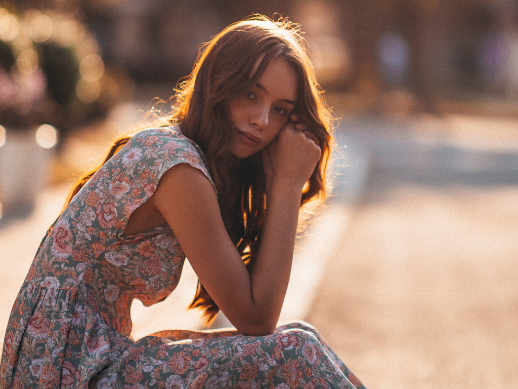 woman-in-white-and-brown-floral-dress-sitting-on-gray-concrete-road-during-daytime-5k-8f.jpg