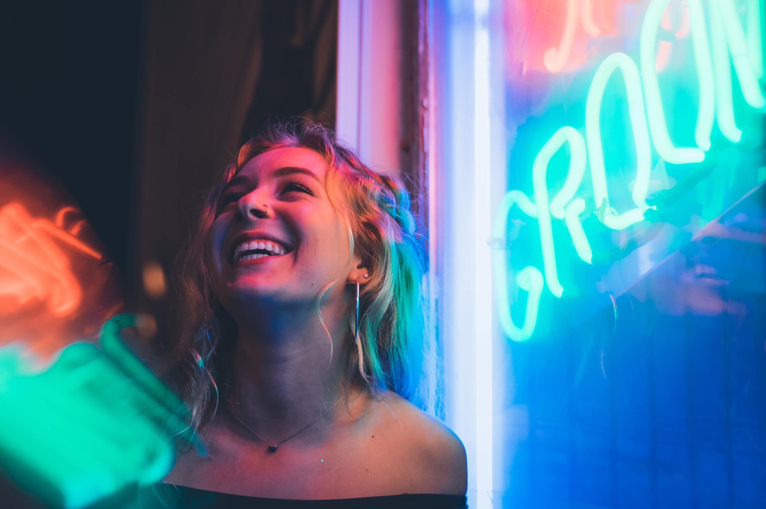 woman-smiling-near-glass-window-5k-v3.jpg