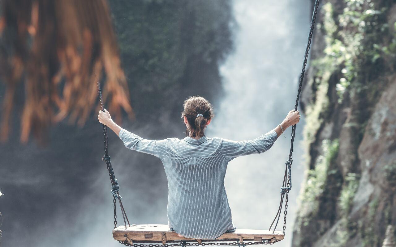 woman-swings-near-waterfall-5k-h4.jpg