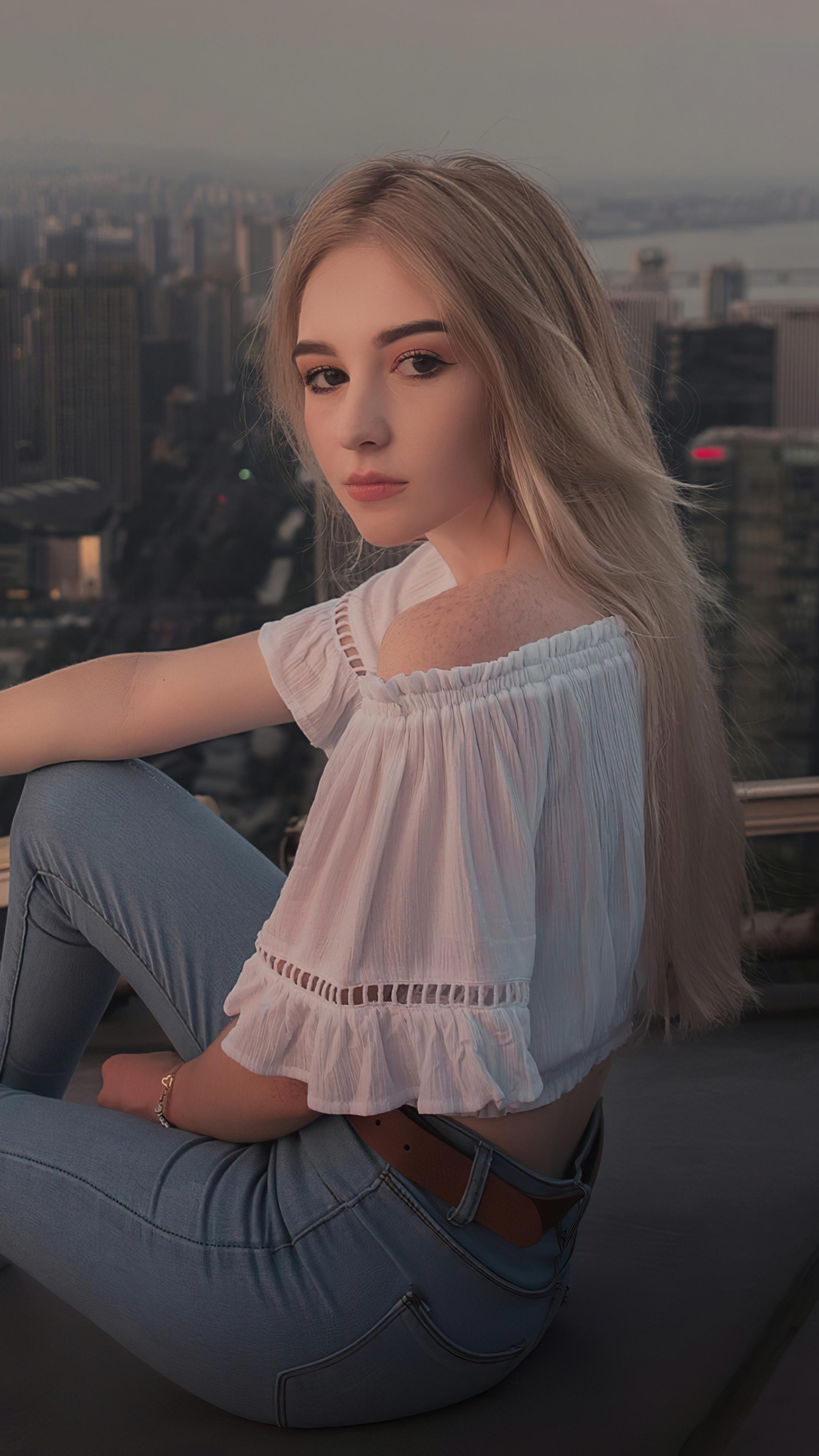 2160x3840 Girl Sitting Messy Hair Outdoor Sony Xperia X,XZ