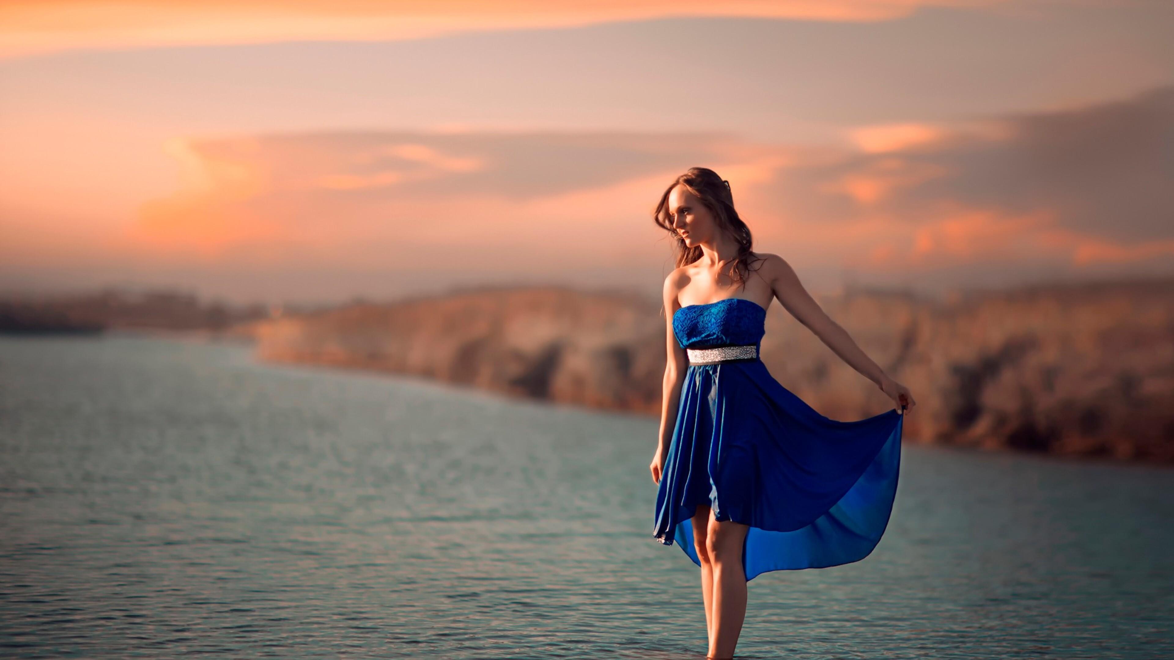 women-outdoor-sea-4k.jpg