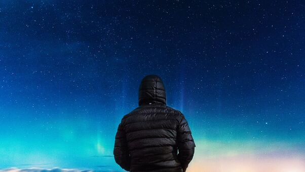 alone-boy-in-hoodie-looking-towards-colorful-sky-g0.jpg