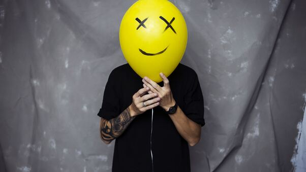 boy-with-smiley-balloon-on-face-e9.jpg