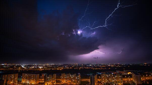 cityscape-lightning-under-purple-sky-5k-po.jpg