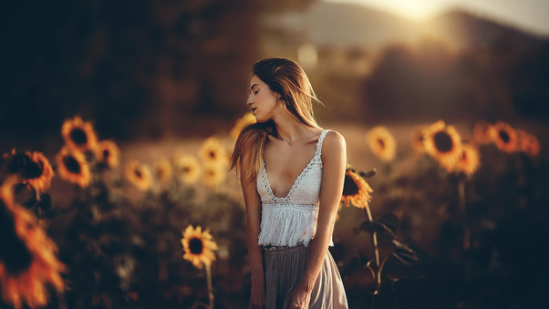 girl-sunflower-field-4k-8d.jpg