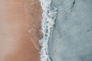 Aerial Beach Waves At Sea Shore Wallpaper