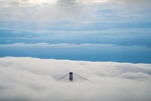 Aerial View Of Bridge Under Clouds 8k