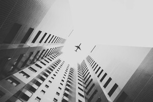 Airplane Flying Above Skyscrapers Wallpaper