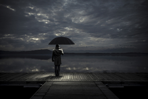 Alone man With Umbrella Wallpaper