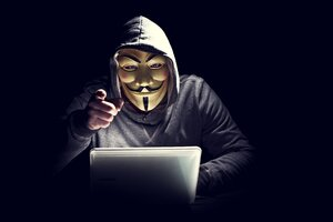 Anonymus Hacker In Mask Pointing Finger Wallpaper