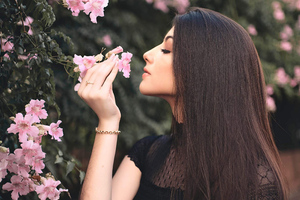 Attractive Beautiful Girl Smelling Flowers