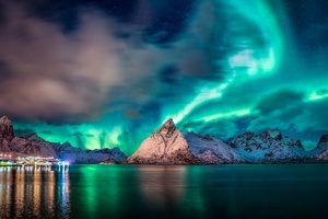 Aurora Reflection Over Mountains
