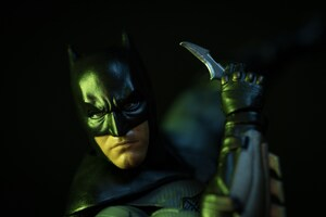 Batman Holding Bat Sign