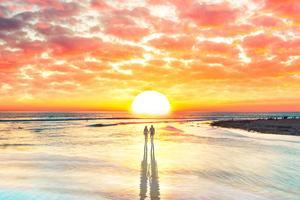 Beach Couple Watching Sunset 4k