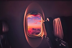 Beautiful Sunset Through Airplane Window