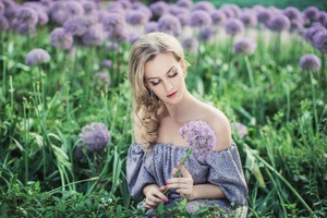 Beautiful Women With Flowers In Field Wallpaper