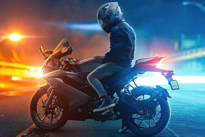 Biker On Road Lights 4k Wallpaper