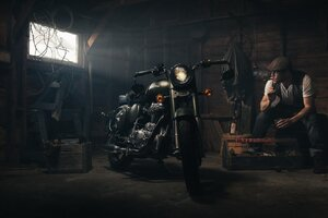 Biker Smoking Garage Wallpaper