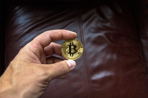 Bitcoin Coin In Person Hand