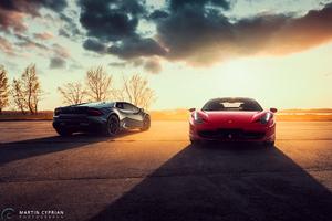 Black Lamborghini Huracan And Red Ferrari 458