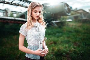 Blonde Girl Flower In Hand 4k Wallpaper