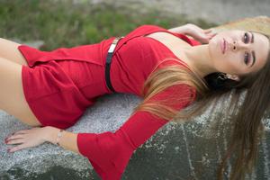 Blonde Girl Red Dress Lying Over Rock Wallpaper