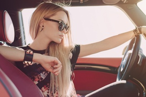 Blonde Girl Sitting In Car Wallpaper
