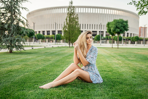 Blonde Girl Sitting In Park Wallpaper