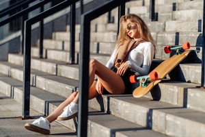 Blonde Girl Sitting On Stairs With Skateboard 4k