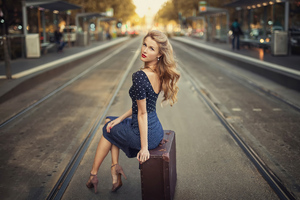 Blonde Girl Sitting Suitcase Train Station 4k Wallpaper